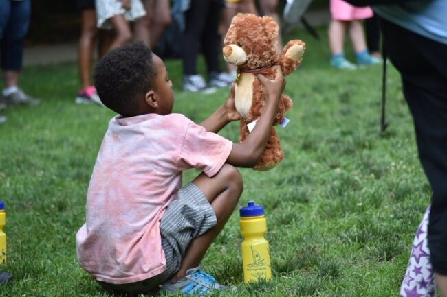 Young boy holding teddy bear